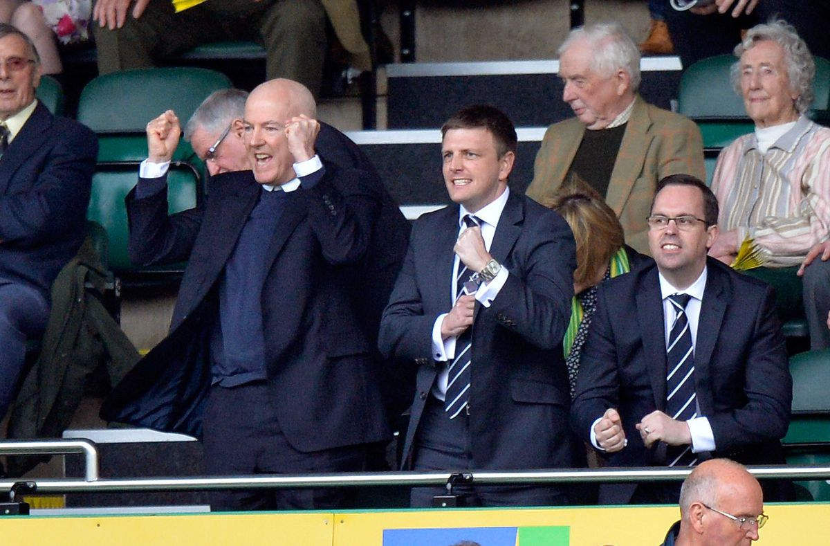 Garlick celebrates an Albion goal with former owner Jeremy Peace, left.