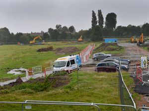 Workers on site as construction of the new Commonwealth Games pool gets started at Smethwick's Londonderry playing fields