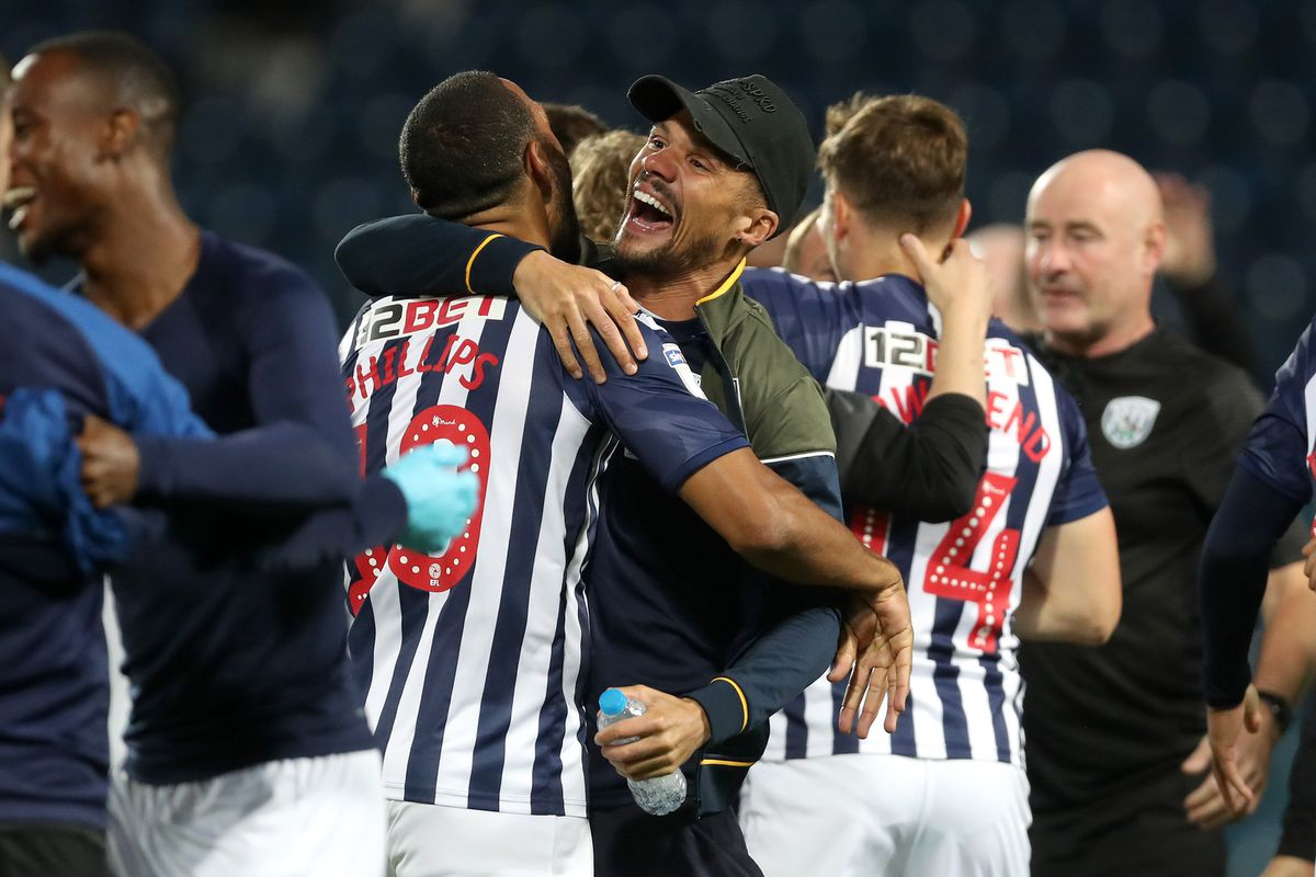 Matt Phillips of West Bromwich Albion and Kieran Gibbs of West Bromwich Albion embrace as they celebrate promotion to the Premier League on the pitch at the end of the match. (AMA)