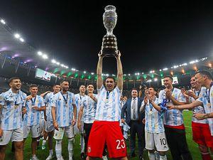 Argentina's goalkeeper Emiliano Martinez hoists the trophy after beating Brazil 1-0 in Copa America final soccer match at the Maracana stadium in Rio de Janeiro, Brazil, Saturday, July 10, 2021. (AP Photo/Bruna Prado)