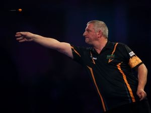 Wayne Jones in action during the walk on during day five of the William Hill World Darts Championships at Alexandra Palace, London. PRESS ASSOCIATION Photo. Picture date: Monday December 17, 2018. Photo credit should read: Steven Paston/PA Wire.