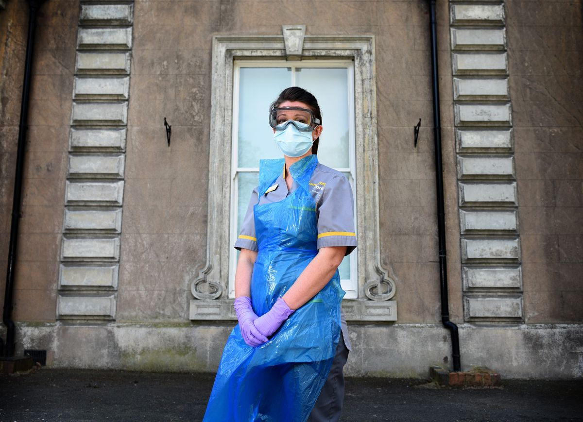 Clinical nurse specialist Charlotte Stubbs wears the full PPE outfit at Compton Care, Wolverhampton