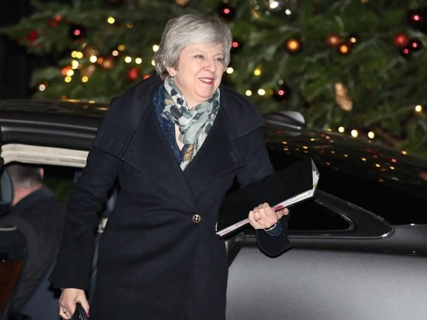 Theresa May remains PM after fighting off bid to oust her as Tory leader