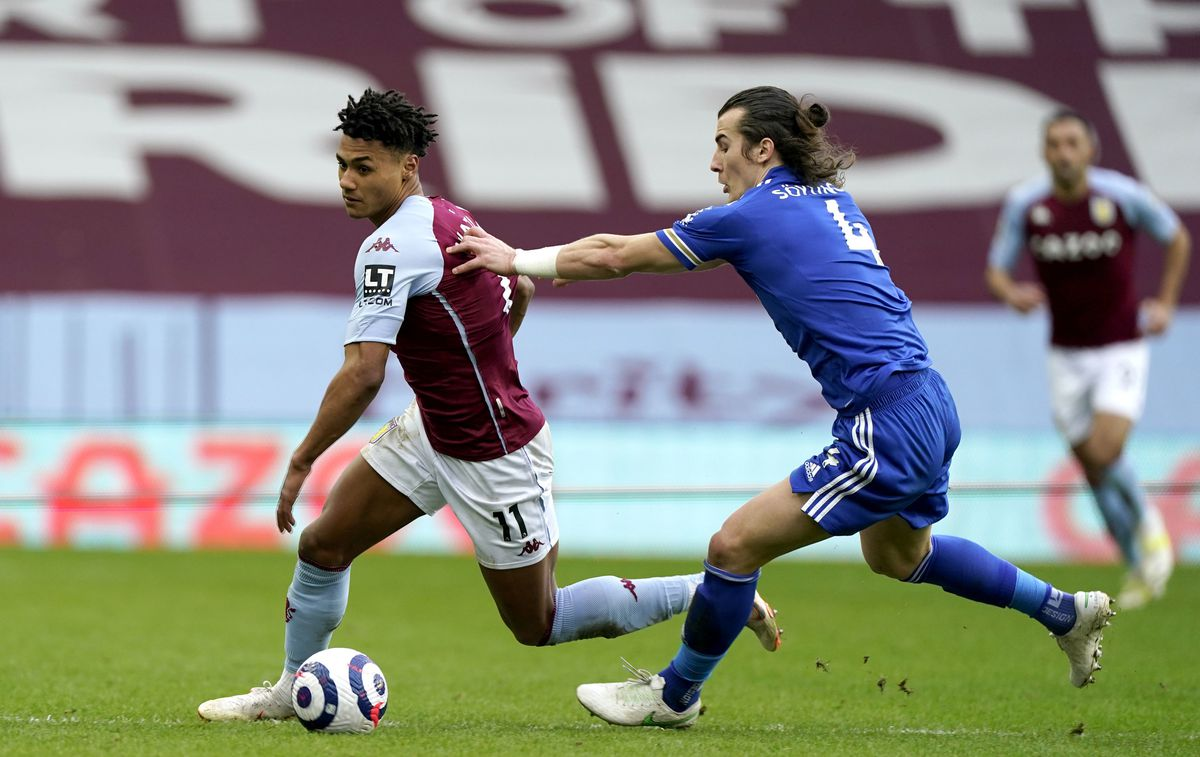 Aston Villa's Ollie Watkins (left) and Leicester City's Caglar Soyuncu battle for the ball