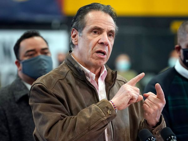 Andrew Cuomo speaks with his hands up near his face