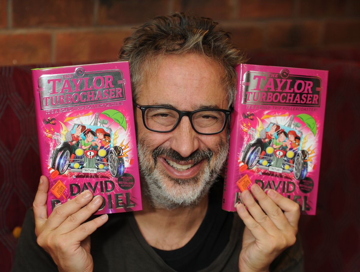 David Baddiel at Wolverhampton Grand Theatre, with copies of his book The Taylor Turbocharger