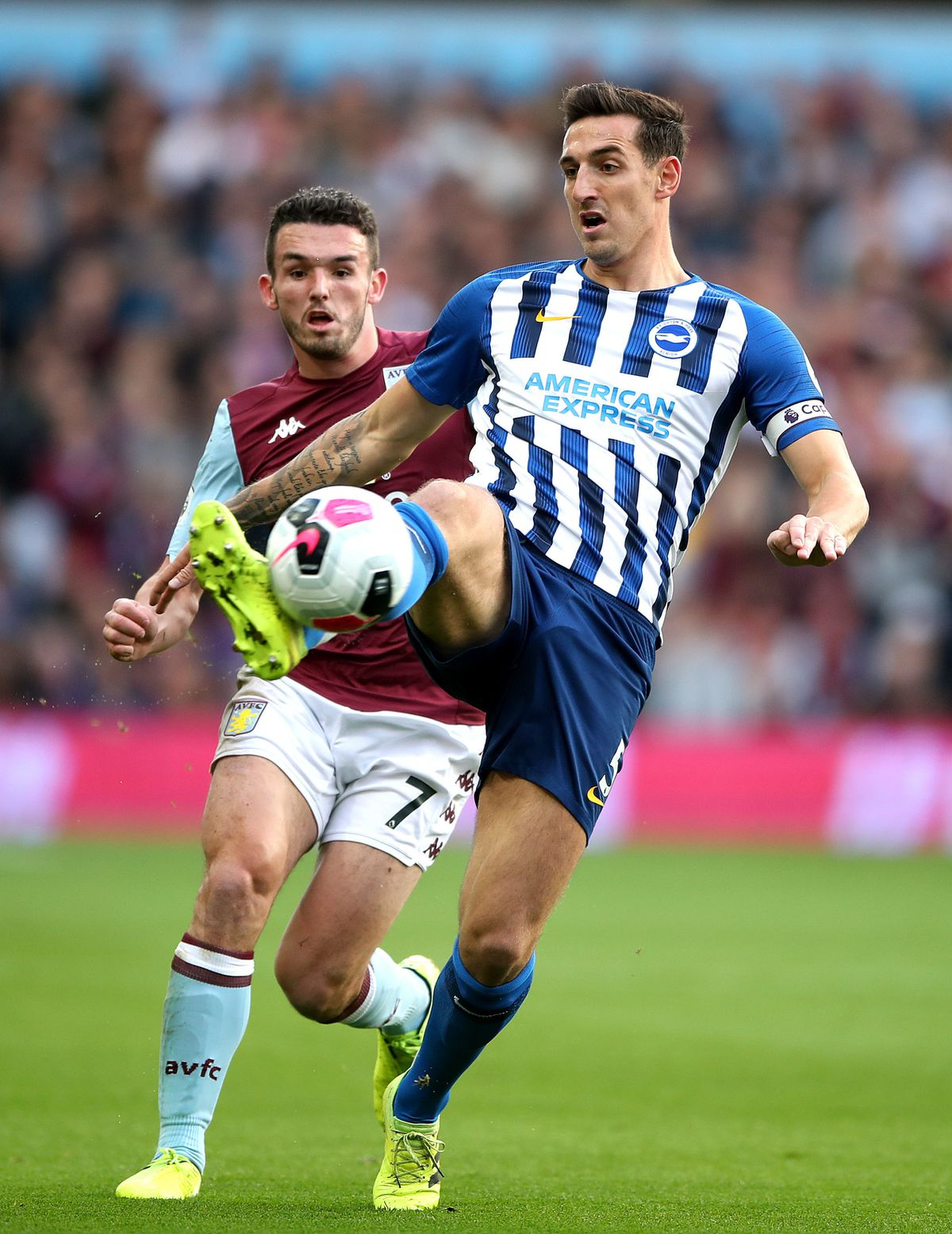 Aston Villa's John McGinn (left) and Brighton and Hove Albion's Lewis Dunk (right) battle for the ball