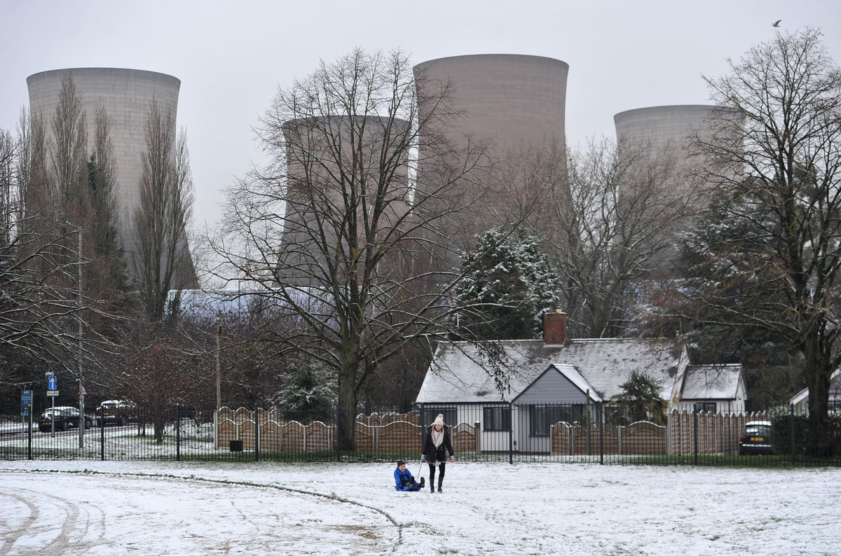 A sledge ridge in the snow near Rugeley's power station towers