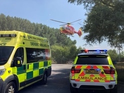 Man airlifted to hospital after crash between car and tractor
