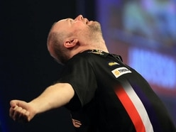 Raymond Van Barneveld gets one over old rival Phil Taylor in charity match