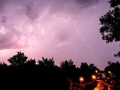 Downpours and double rainbows seen as thunderstorms hit the region