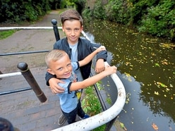 'He kept his head and didn't panic': Hero Morgan, 10, saves young pal from drowning after he plunges into canal in Wordsley