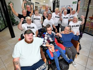 Residents from Broad Meadow, Dudley, have raised £2,000 to help Dylan Price who needs two major operations. Dylan is pictured centre front with uncle Robert Pierce, nan Linda Pierce, and residents who raised the money.