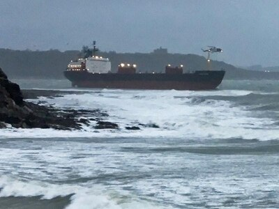 Rescue bid under way after Russian cargo ship runs aground off Cornish beach