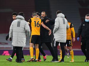 Nuno Espirito Santo embraces skipper Conor Coady after the win at Arsenal (AMA)