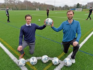 Director of the football academy Andrew Dickinson and director of sports, Andrew Guppy pose on the new 3G pitch