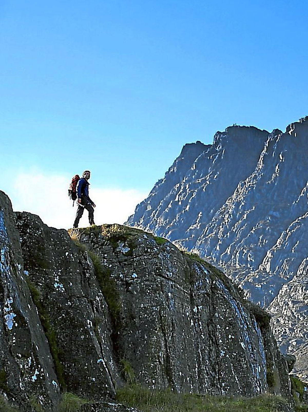 Tryfan in Snowdonia which topped a survey by hillwalking magazine Trail, with Helvellyn in the Lake District coming second and Wales' highest mountain Snowdon securing third place.