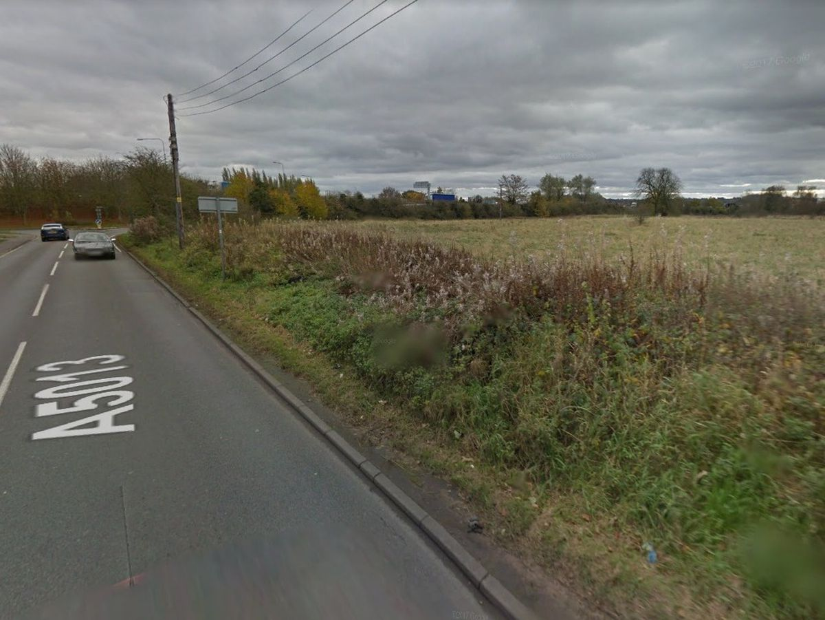 A Google Street View Image Of The Land Off Creswell Grove Near Stafford Earmarked For A Petrol Station And Major Development. M6 Is In The Background