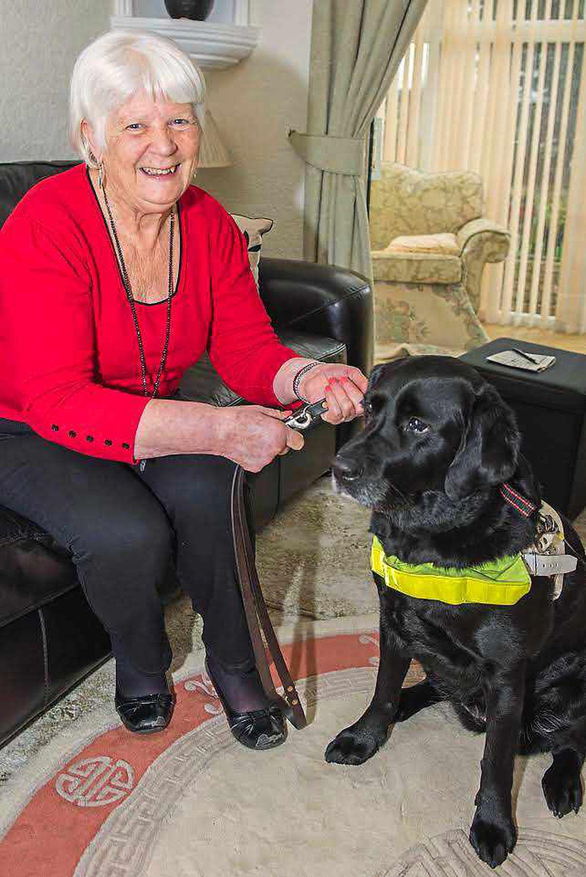 Rita Nicholls and her guide dog Charlie