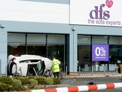 Men critically injured as car crashes into DFS shop after police chase