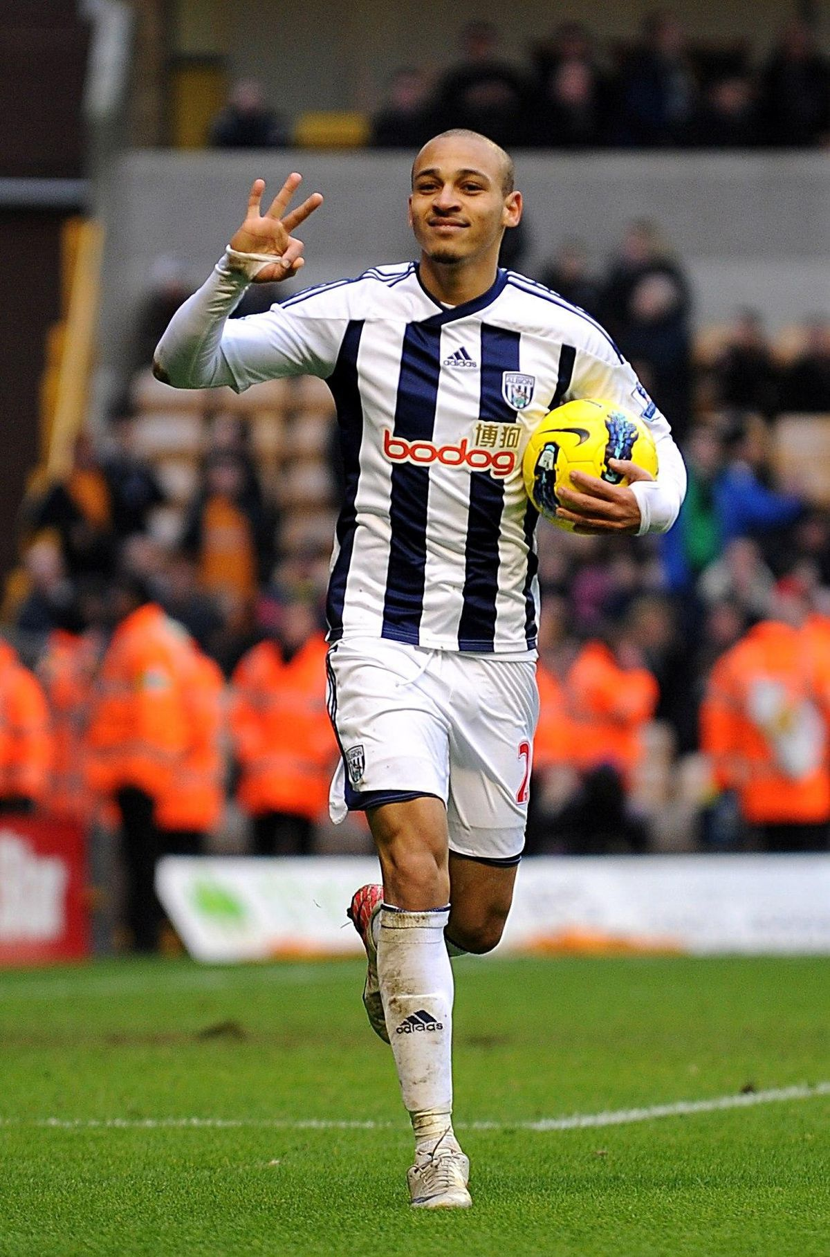 West Bromwich Albion's Peter Odemwingie celebrates completing his hat-trick and scoring his sides fifth goal during the Barclays Premier League match at the Molineux.