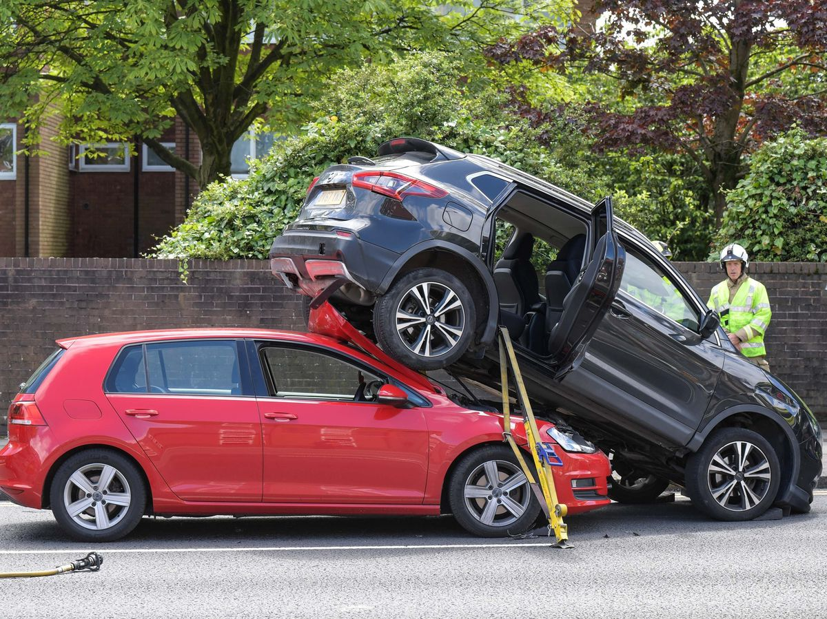 The Nissan Qashqai seemed to be parked on top of the red VW Golf after the collision this afternoon. Photo: SnapperSK