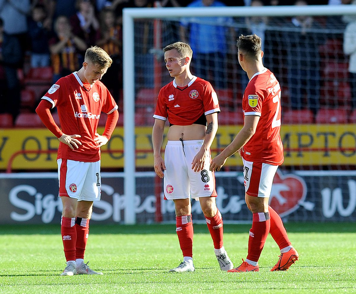 Dejected Saddlers including Liam Kinsella after the own goal.
