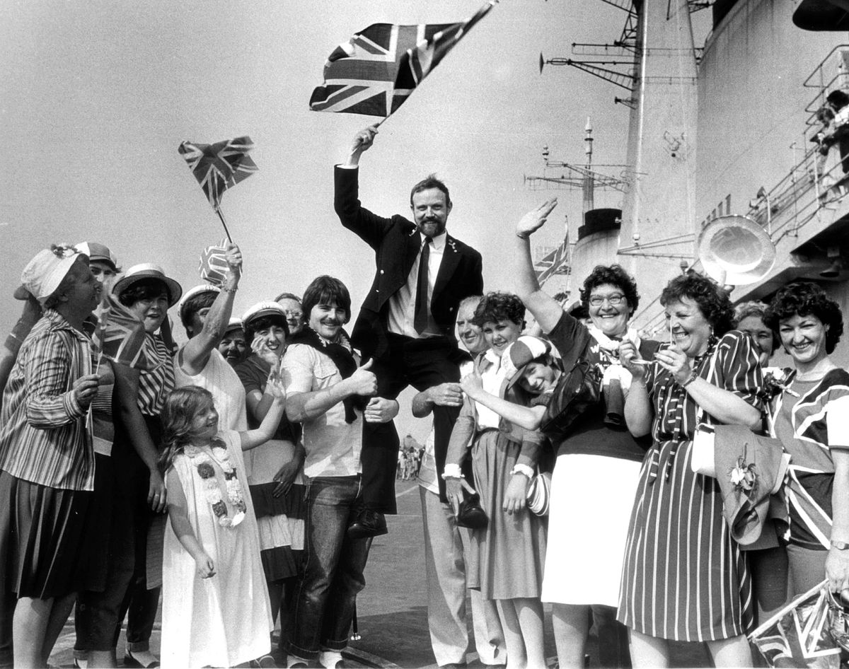 Chief Stoker Dave Tisdale gets a lift from his family and friends who traveled from West Bromwich and Walsall to welcome him home from the Falklands at Portsmouth in 1982.