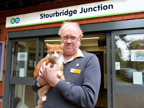 George the cat and Station Supervisor Ian Tomlinson after Stourbridge Junction came second in the World Cup of Stations, narrowly losing to Glasgow Queen Street.