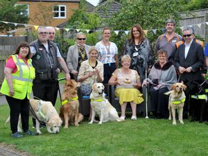 A Guide Dog party at the Beacon Centre to celebrate Assistance Dog week. The event was attended by the Deputy Mayor of Dudley, Councillor Sue Greenaway, seated centre. She is seated with Lisa Cowley, chief exec of the centre, and Kathy Roper, chair of the trustees