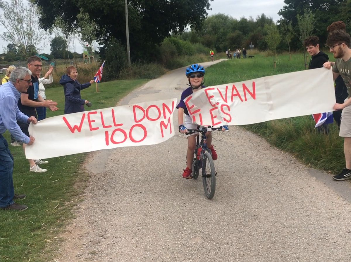 Evan crossing the finishing line of his 100 mile charity cycle
