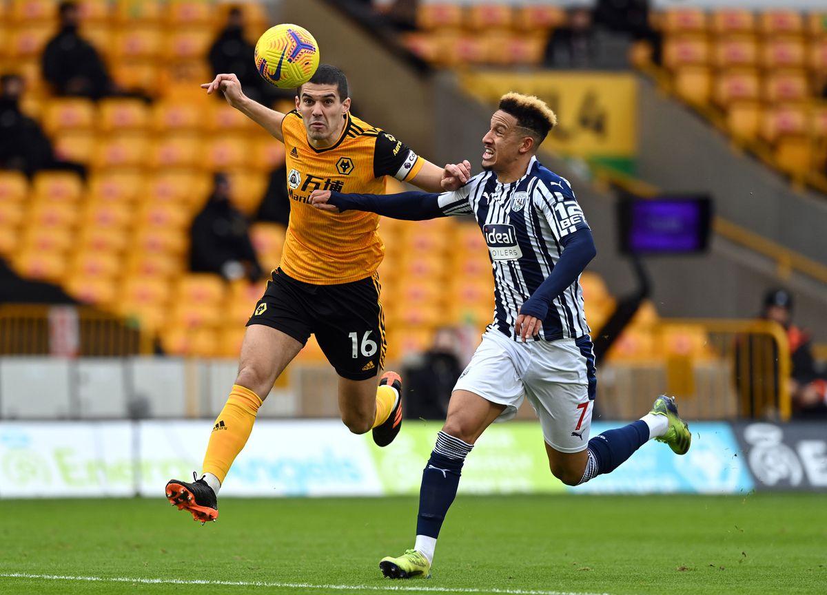 Wolverhampton Wanderers' Conor Coady and West Bromwich Albion's Callum Robinson (