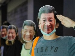 Hong Kong protesters mock Chinese leader in defiance of masks ban