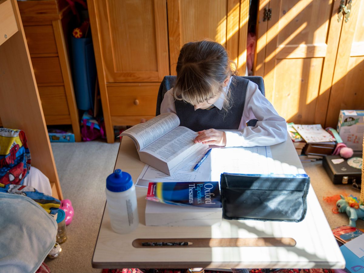 A child being home-schooled during lockdown