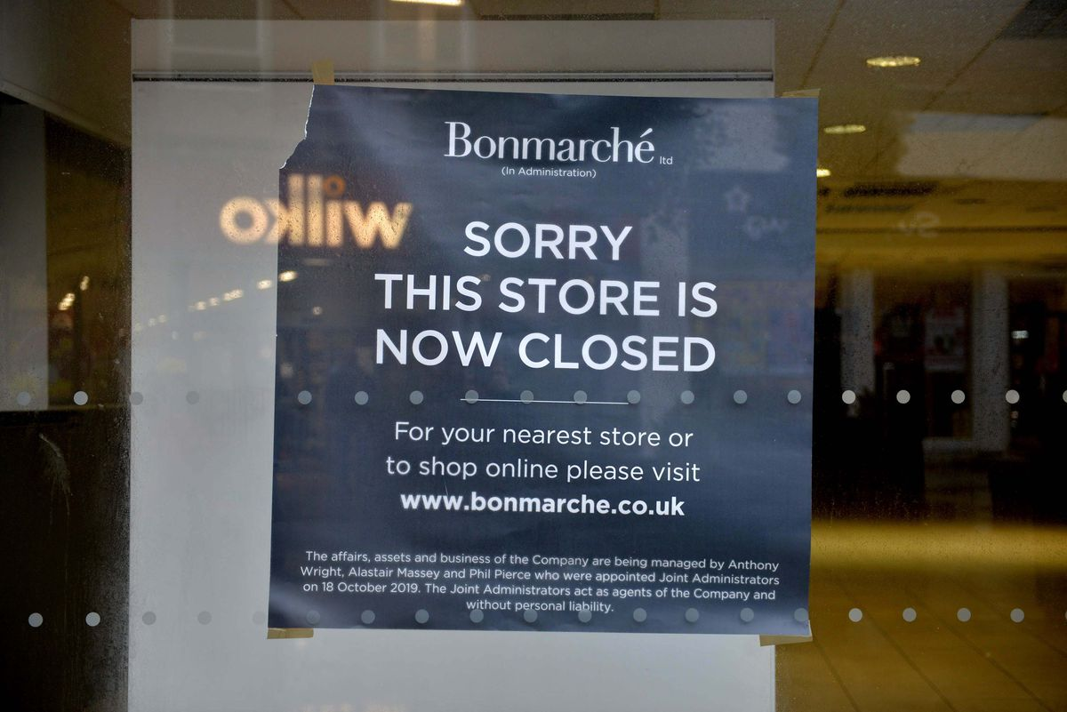 A sign in the window of the closed Bonmarche store