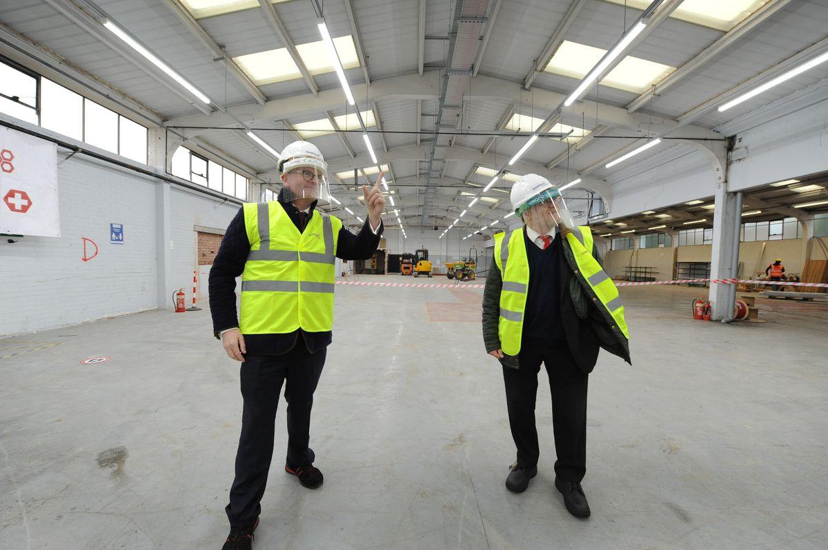 Group sales director Tim Mulqueen shows Warley MP John Spellar around