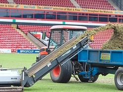 Walsall pitch in to turf work
