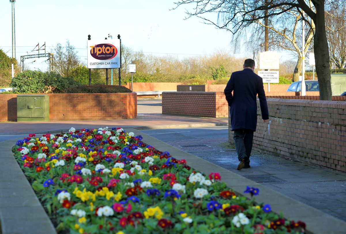 The brightly coloured flower beds outside the Tipton Shopping Centre in Owen Street