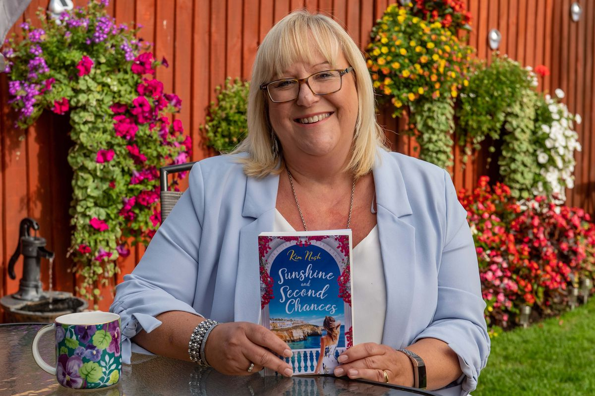 Kim Nash with her book Sunshine and Second Chances