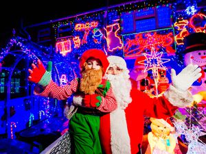 Gary Groves as Father Christmas and his son Thomas, six, as an elf, have for an 11th year decorated their home in Walsall