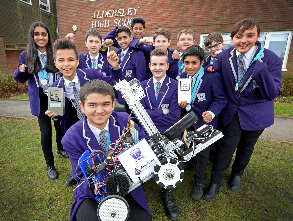 Pupils from Aldersley High School, Wolverhampton, celebrate getting through to the nationals of a robot challenge which took part at RAF Cosford. Pictured is Ryan Taylor, aged 13, with his team mates