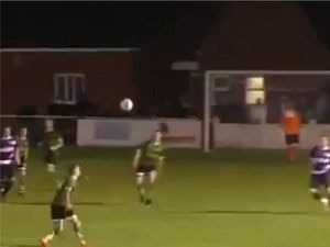 Jake Parker scores a volley for 1874 Northwich in a league game