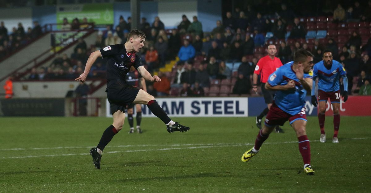 Alfie Bates hammers home Walsall's second goal (Pic: Richard Parkes)