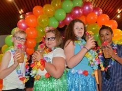 Youngsters enjoy Hawaiian-themed prom put on by social club