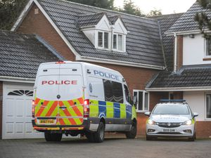 Police outside the home in Trehernes Drive, in Stourbridge. Image: @SnapperSK