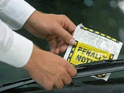 Man fined after punching traffic warden in row over ticket