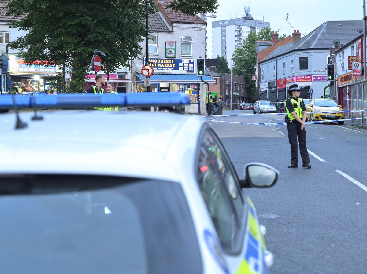 Police at the scene of the fight in Caldmore Green. Photo: SnapperSK