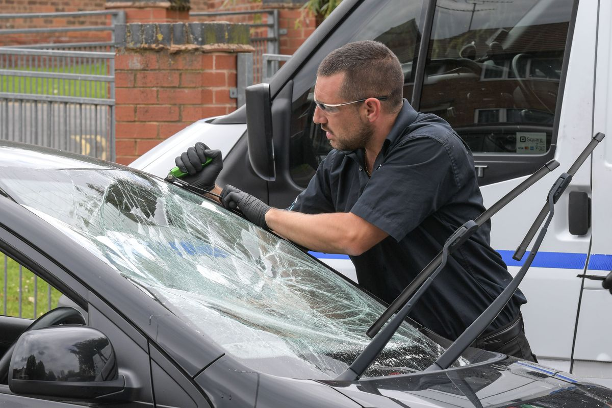 Managing director, Timothy Jinks of E.T.S Emergency Windscreens has been called in to help to repair some of the 42 damaged cars in Edgbaston. Photo: SnapperSK