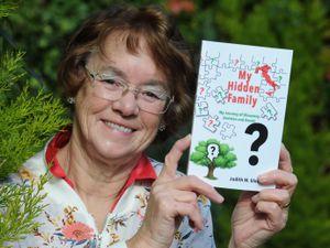 Judith Glover, of Wolverhampton, with her book My Hidden Family