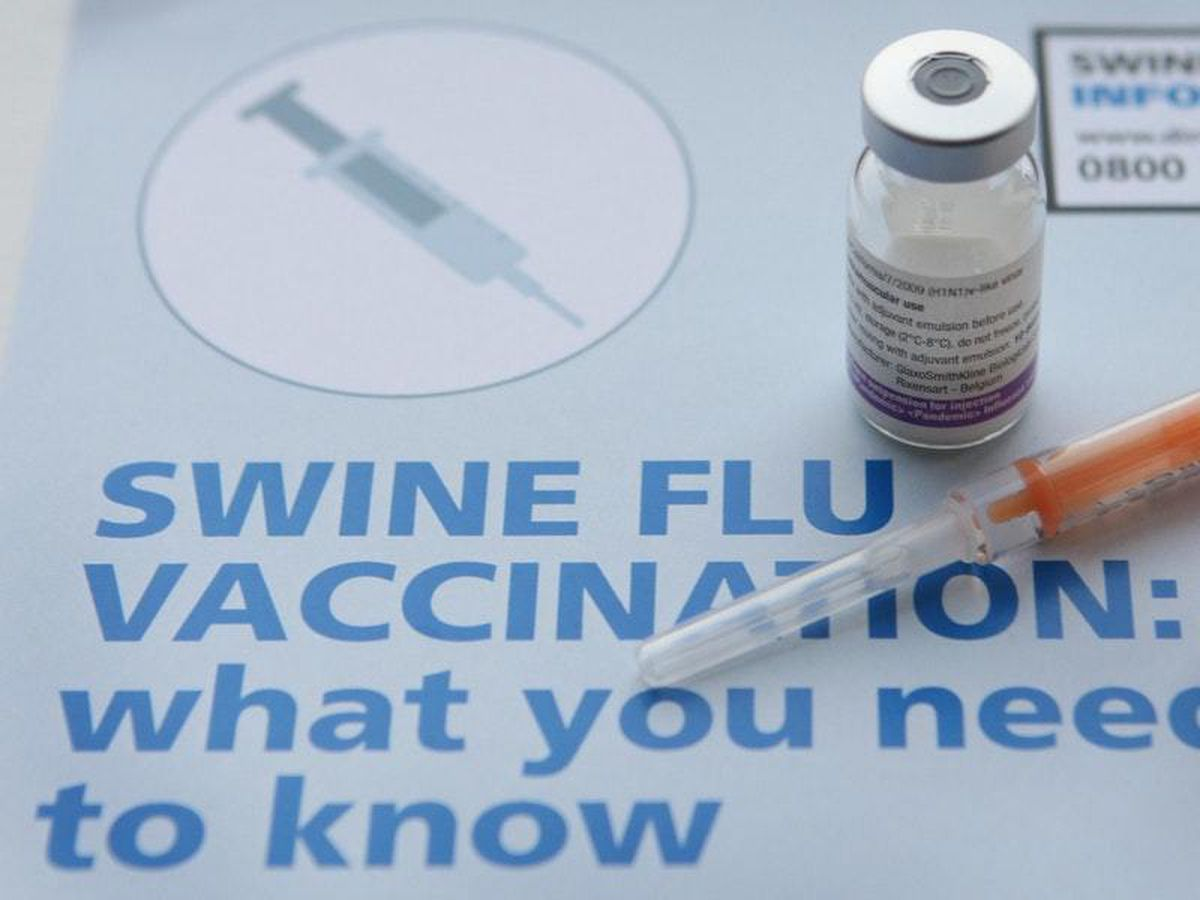 A Swine flu vaccine on top of a Swine flu vaccination poster, pictured in 2009 (Danny Lawson/PA)